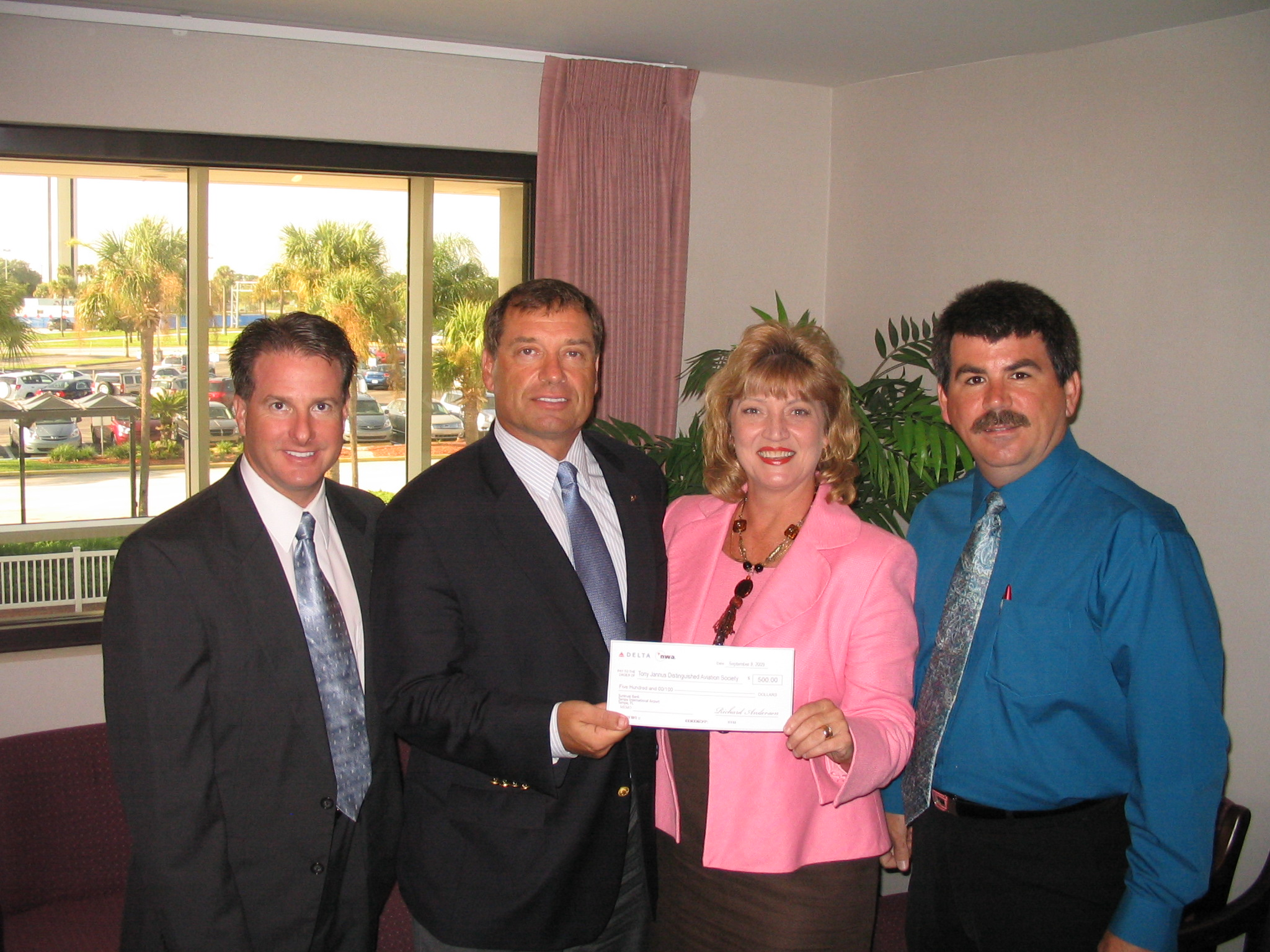 Robert Bohan presenting check to Colleen and Tanker, 8 Sep '09.JPG