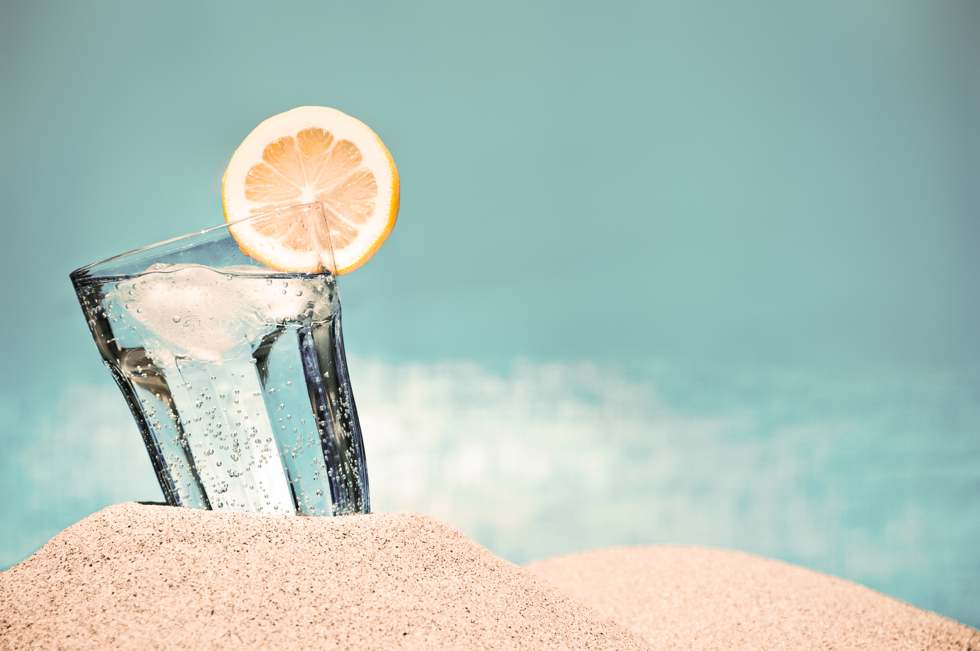 Ready to drink more water? - .... add fresh squeezed lemon juice or lemon oil to it!