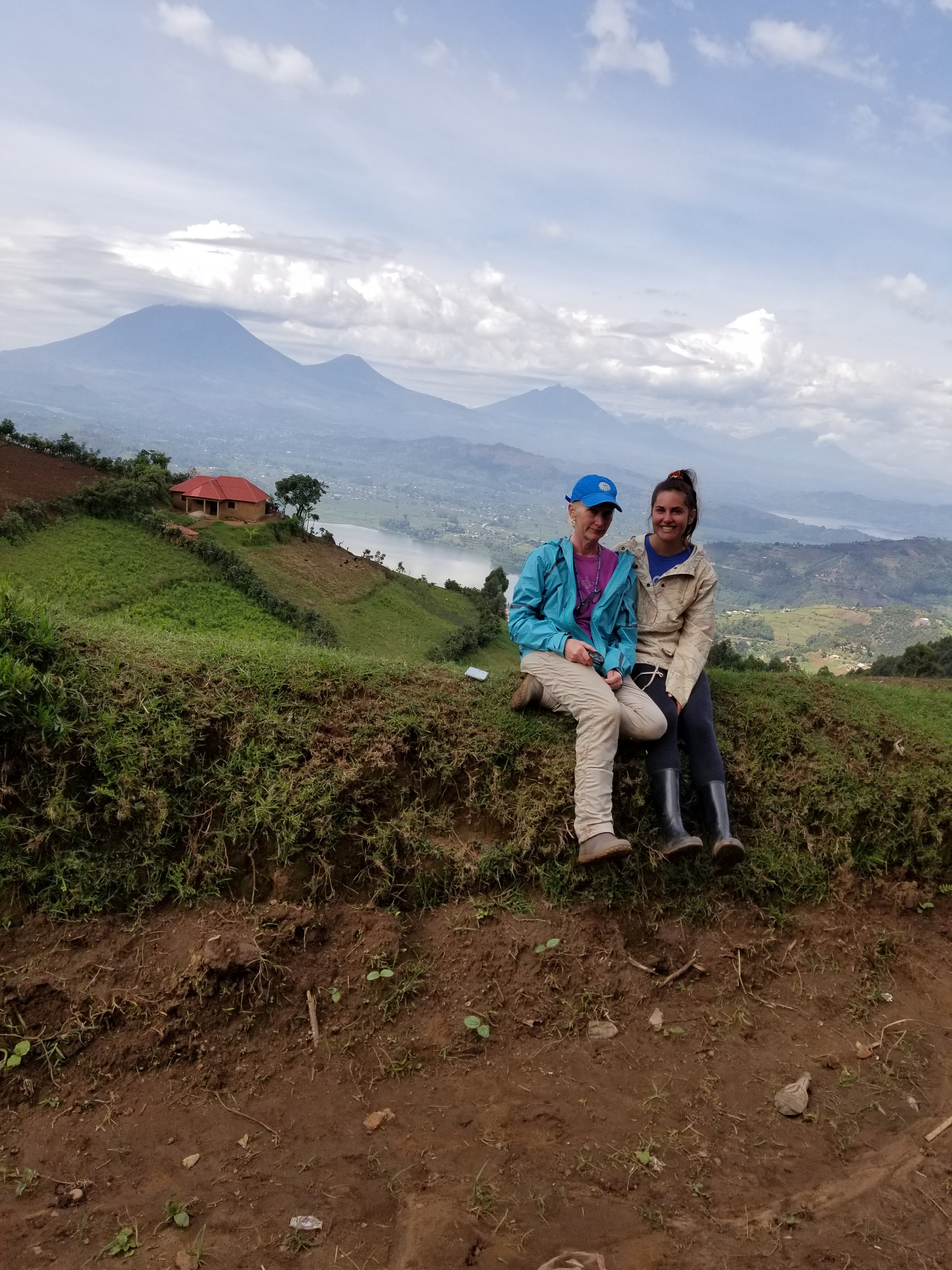 Take your mum to work week(s)! My mum came to visit for two weeks and this is us on our way home from the field with the Virungas in the background.
