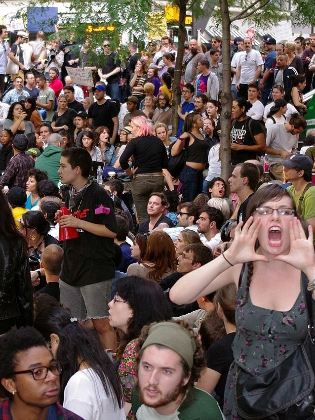 Occupy Wall Street General assembly at Zuccotti Park (New York, 2011)  (Source: Wikimedia Commons. Available online:  https://commons.wikimedia.org/wiki/File:Day_14_Occupy_Wall_Street_September_30_2011_Shankbone_2.JPG  Last accessed: June, 2017)