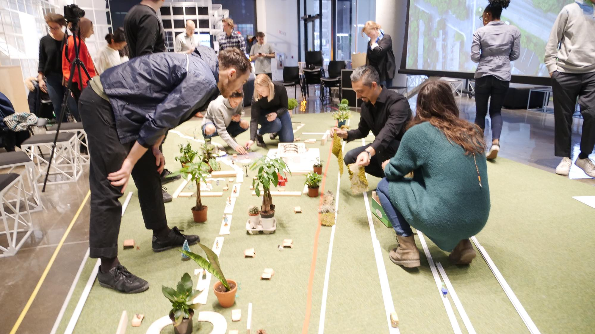 Figure 1. Open planning workshop. Inspired by the open-source culture, pattern language design and wikisystem, we tested the idea of  wikispace . The planning students from Concordia University (Montreal) and community members participated in the design of Coffee Park with the use of an interactive model. Photo: Prem Sooriyakumar (2019). Montreal, QC.