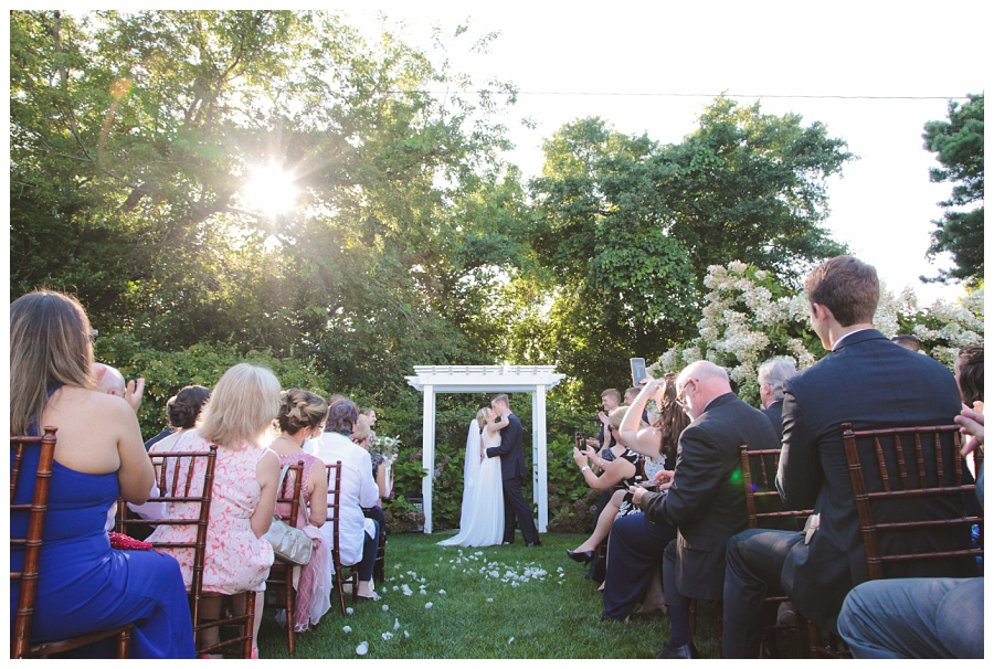 sunset kiss wedding ceremony