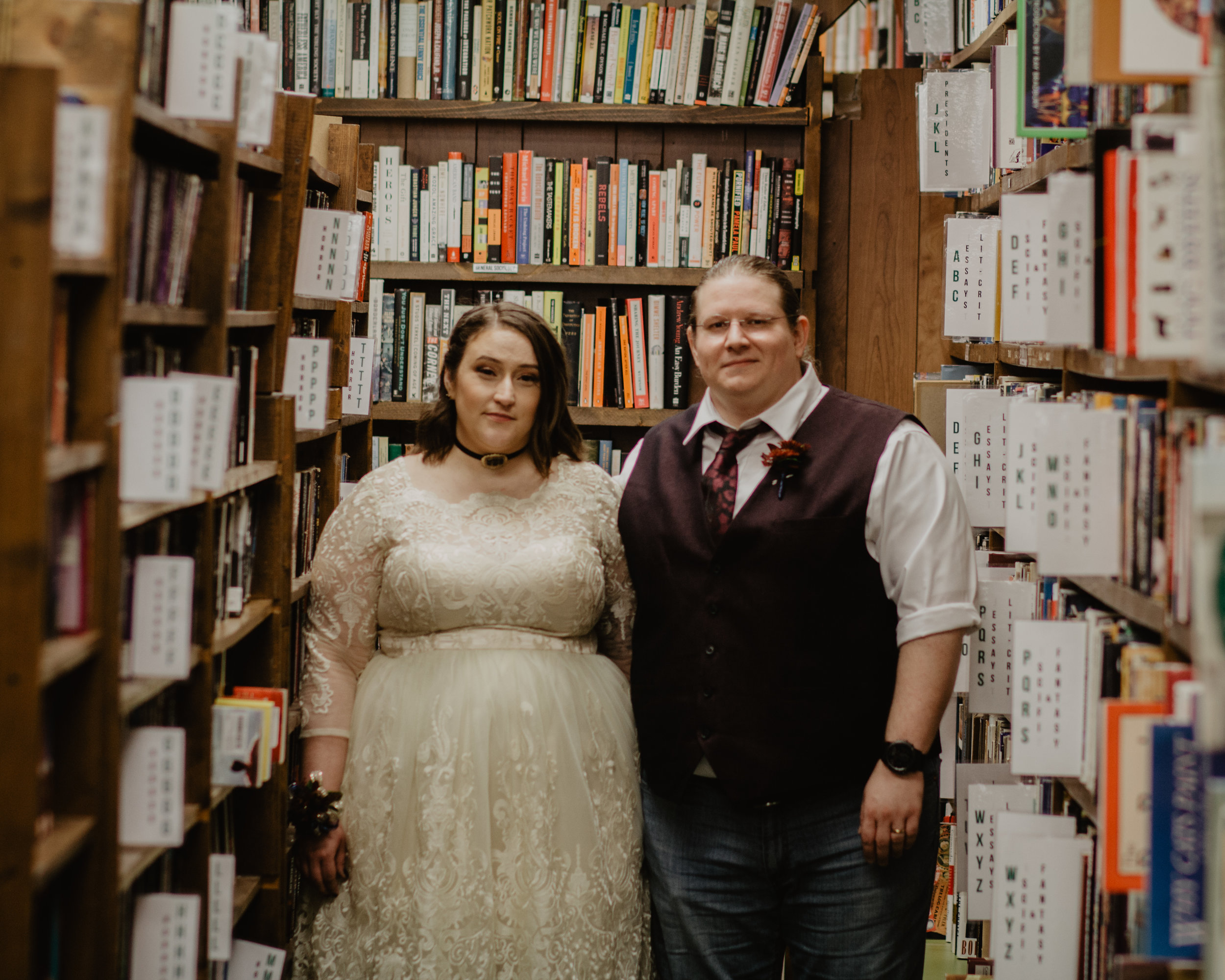 "Ryan and Caitlyn's Wedding - ""I had Bri shoot my very small, outdoor wedding in October 2018. I knew of her work because she had done the photos for my sister's wedding in 2016 and I really liked how she worked and, more importantly, how the photos turned out. To say that I liked my wedding photos would be an understatement. Bri did a fantastic job capturing the feeling of the day. Also, our personalities really jived, so when she suggested some impromptu photos at Books In Stock, I was all for it. There were a total of 10 people at my wedding, and by the end of it, Bri felt just like a second sister. I got a preview that night of a few choice photos and there was great communication about when I could expect the rest. I would highly recommend Henrietta Co. Photography.""-Caitlyn"