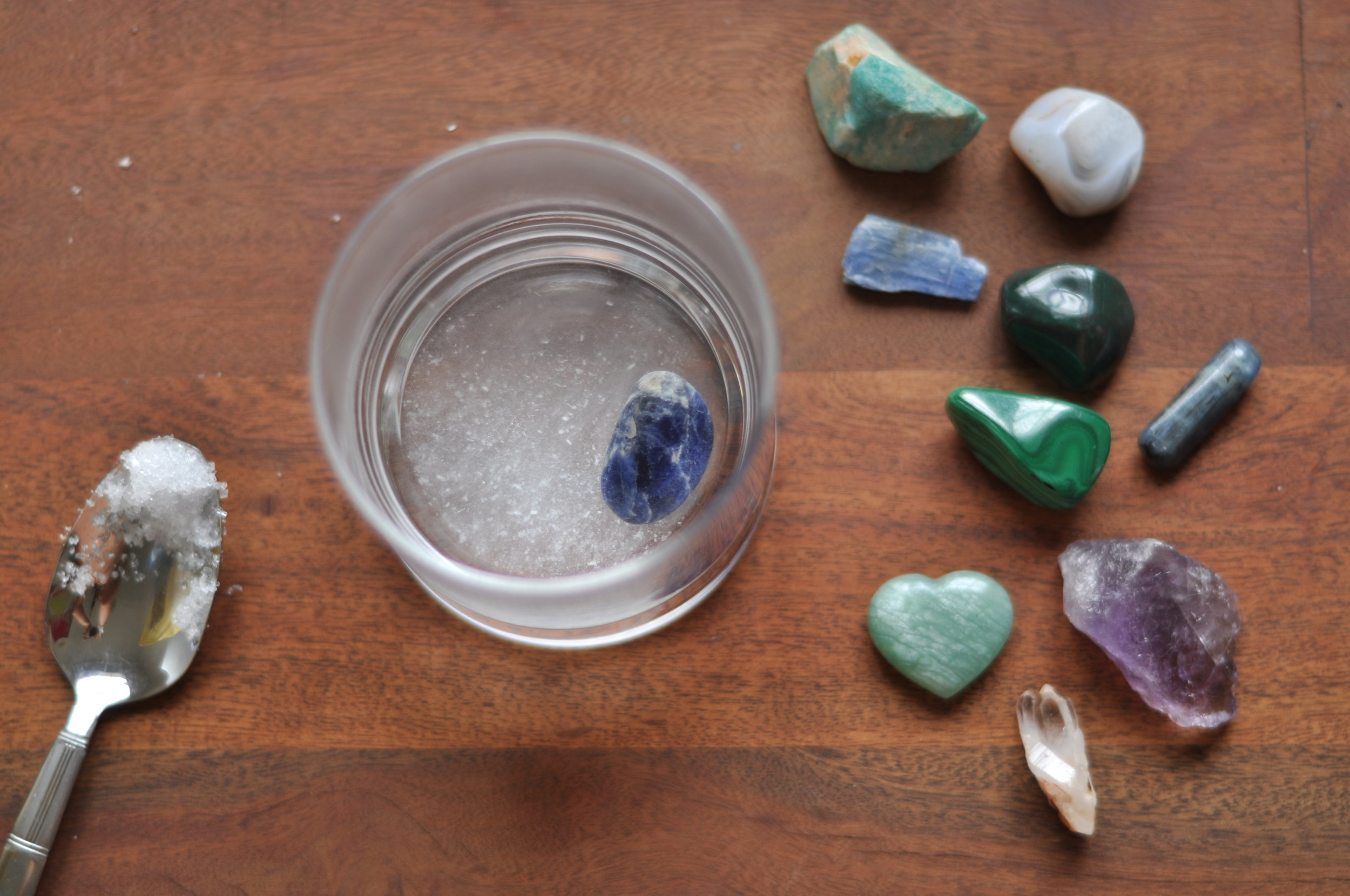 Give 'em a salt water bath  - Drop your crystals in water with himalayan or dead sea salt for up to 24 hours to cleanse their energy.