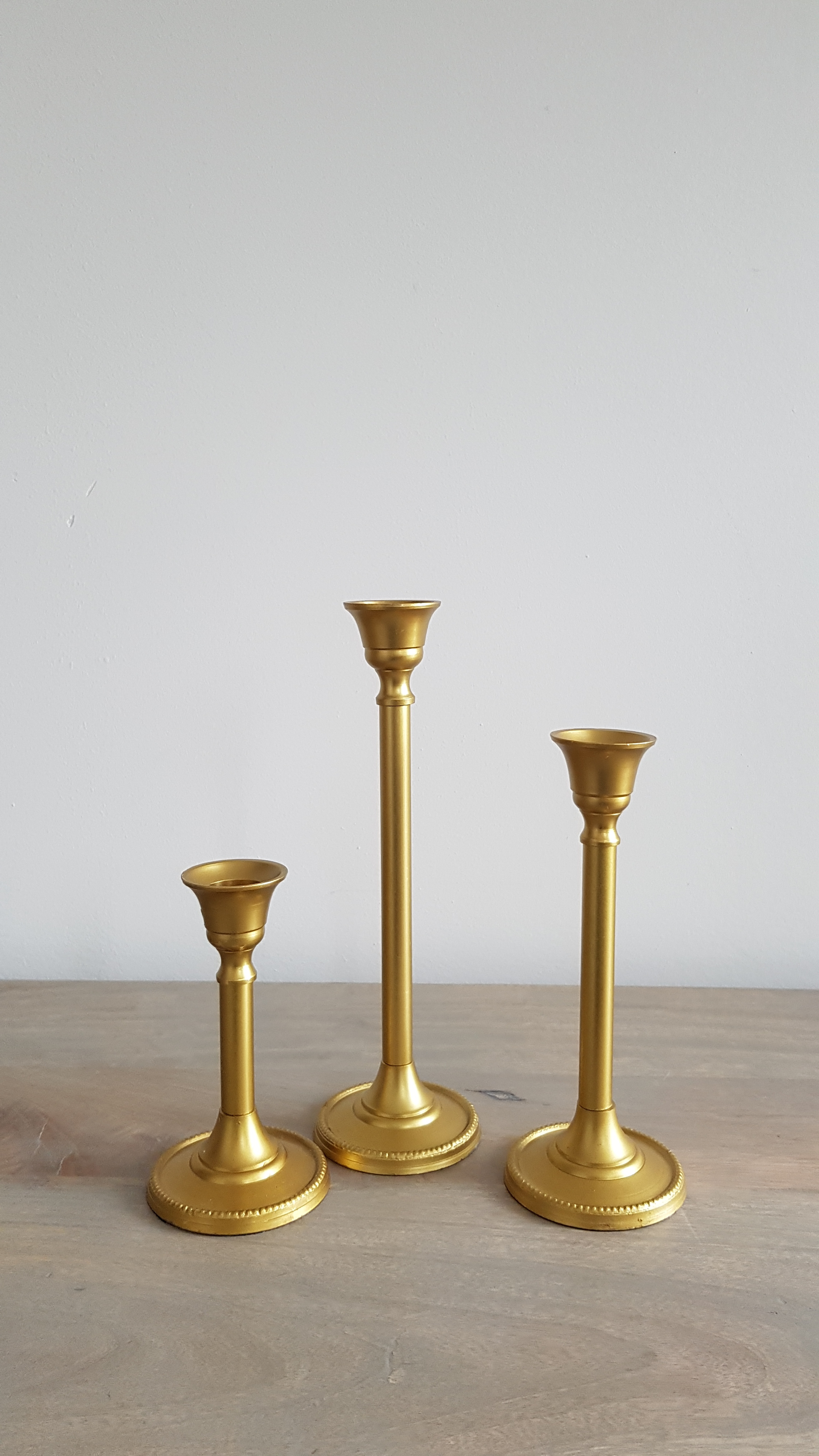 Set of 3 Gold Candlestick Set - $8 a set   Qty: 17 sets (candles not included)