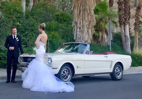 1965 Mustang Convertible - This white-on-red '65 Mustang convertible is a standout model with the red leather interior. The classic American car for a cruise!