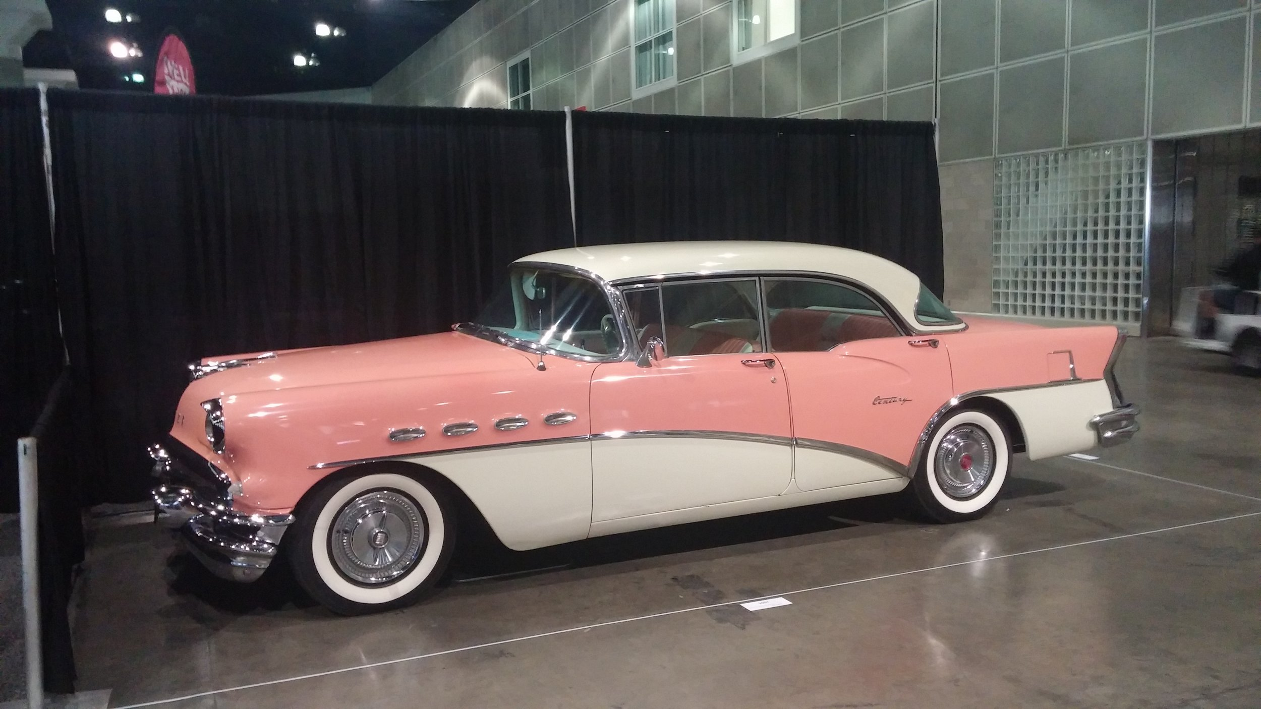 """1956 Buick Century - """"This Salmon and Cream beauty was purchased in derelict condition by our Dad in 1991. She was so ugly that we named her Josephine only because the name Christine was taken by the devil car featured in a horror movie back in the 70s. She was purchased as a project hobby for our Dad to keep busy after he retired and once my he finished restoring her she turned out to be absolutely beautiful."""""""