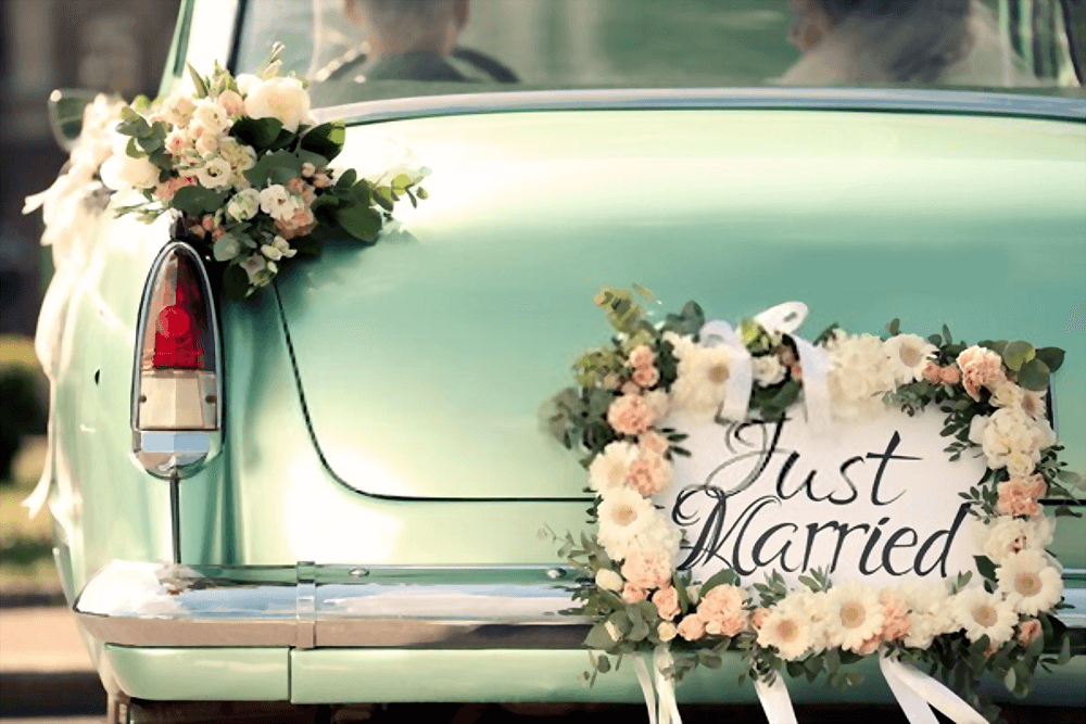 Beautiful-classic-wedding-car-with-plate-JUST-MARRIED.png