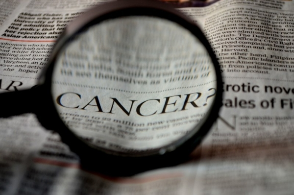 cancer-newspaper-word-magnifier-magnifying-glass (1).jpg