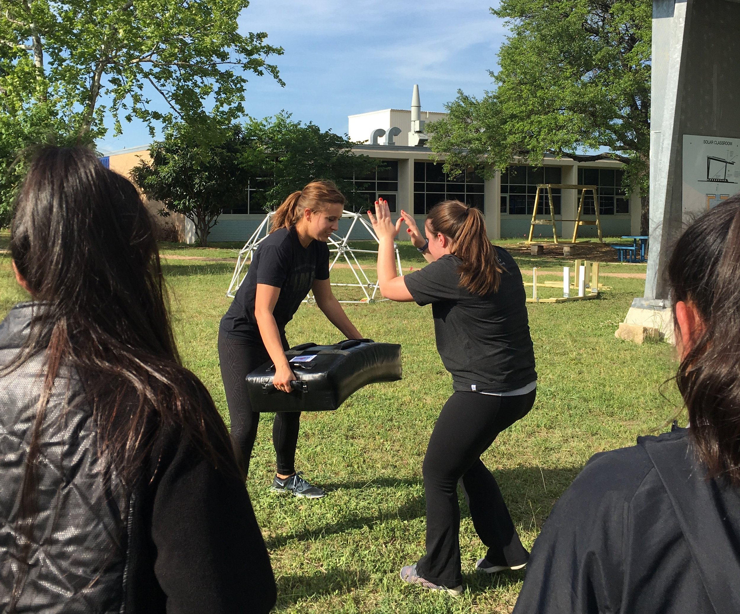 Christina and Millicent demonstrating defensive moves to some of our GwG participants.