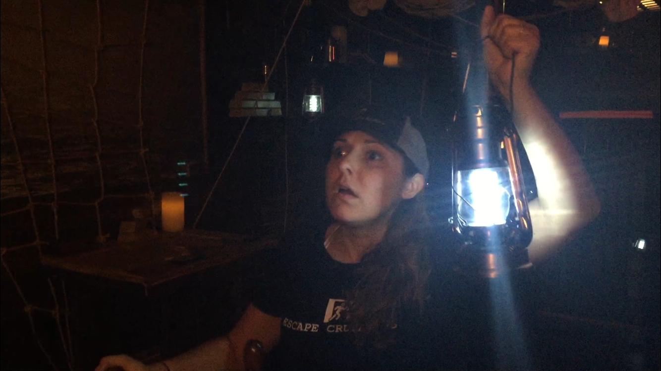 Mel Searching in a pirate ship at  Daytona Escape Room  CHECK OUT  OUR REVIEW HERE