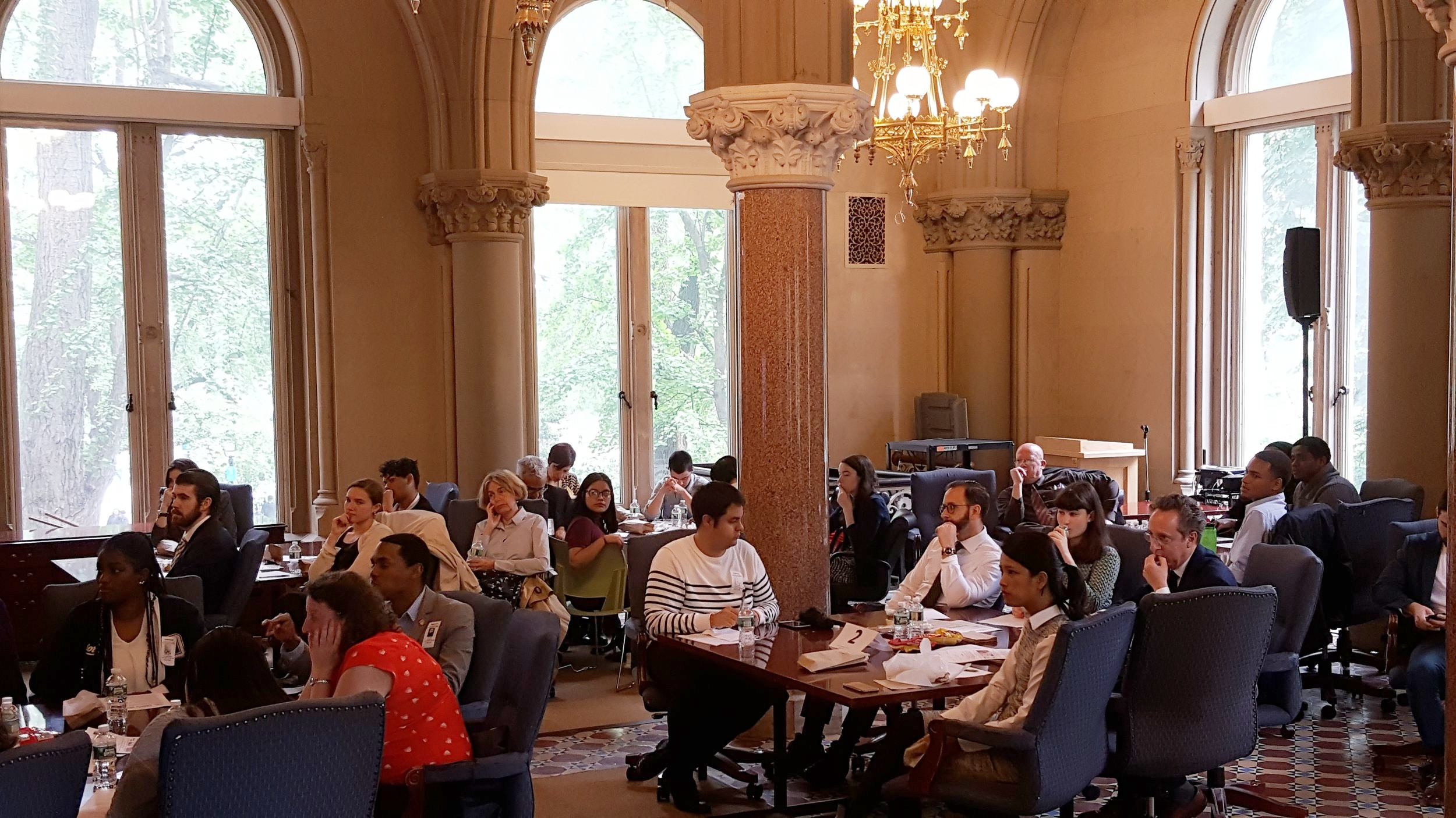 Guests listen intently to student presenters at the luncheon.