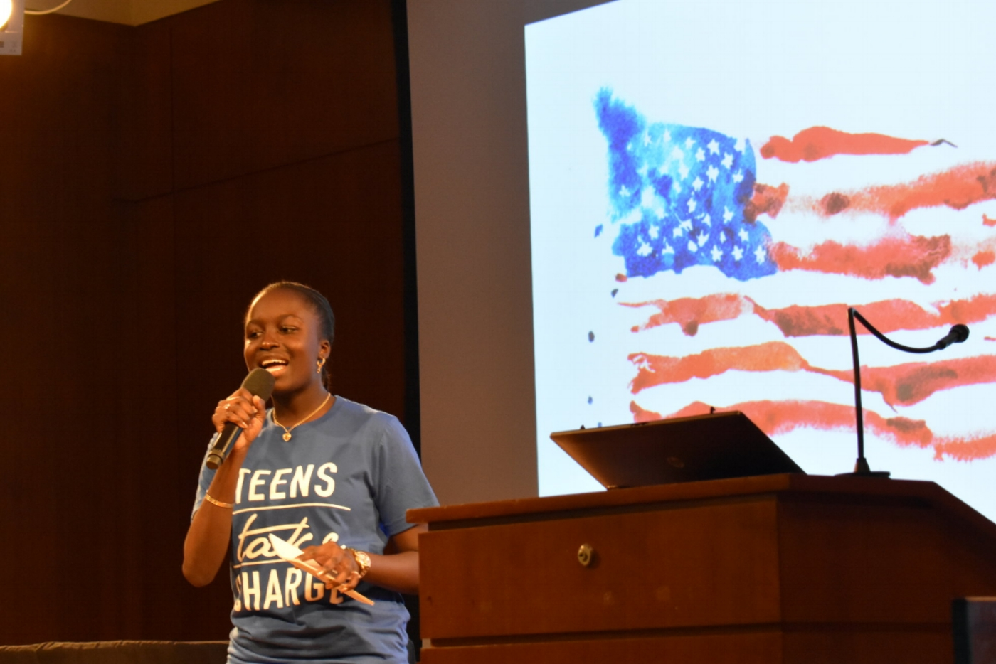 Event emcee Sokhnadiarra Ndiaye kicked off the event by reflecting on the false promises of the American Dream.  Photo by Julian Giordano