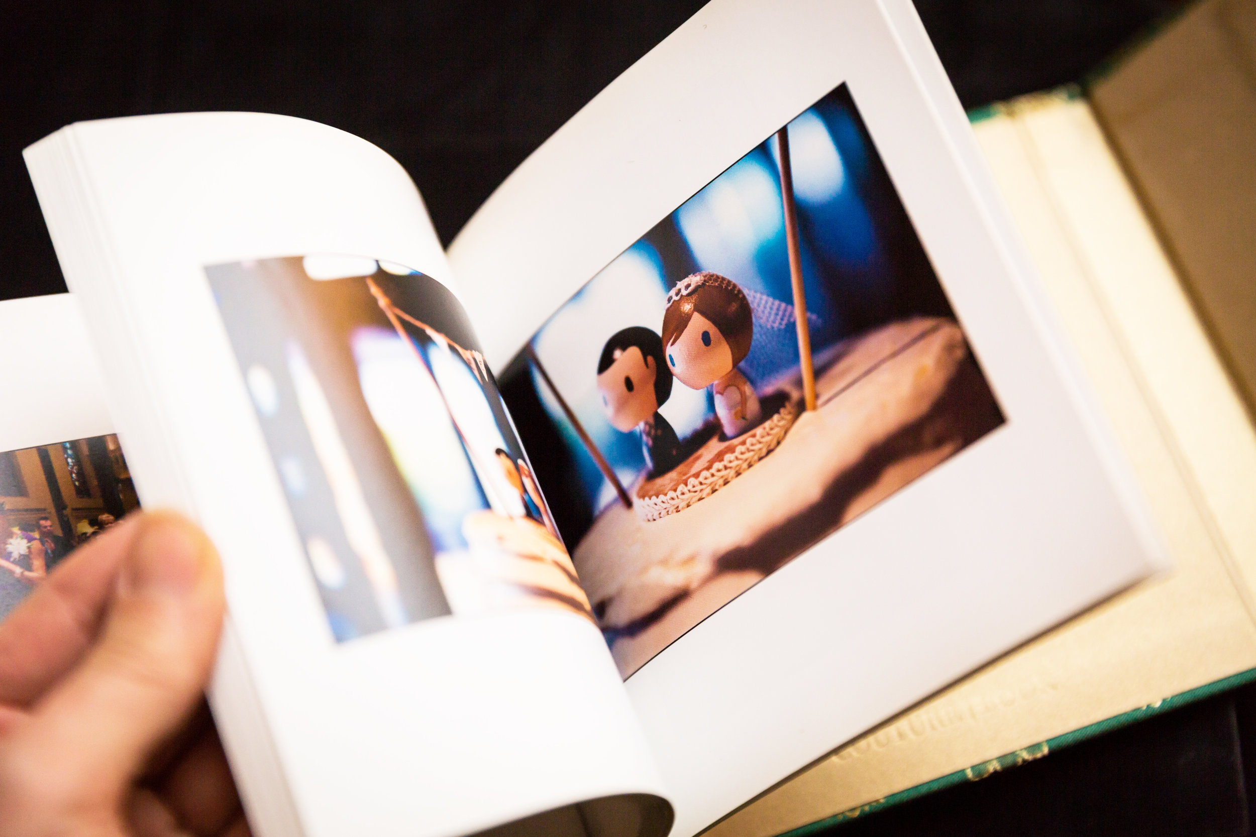 Hand flipping through wedding album