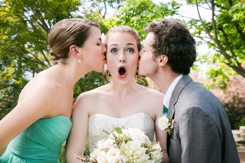 Bride being kissed on both cheeks