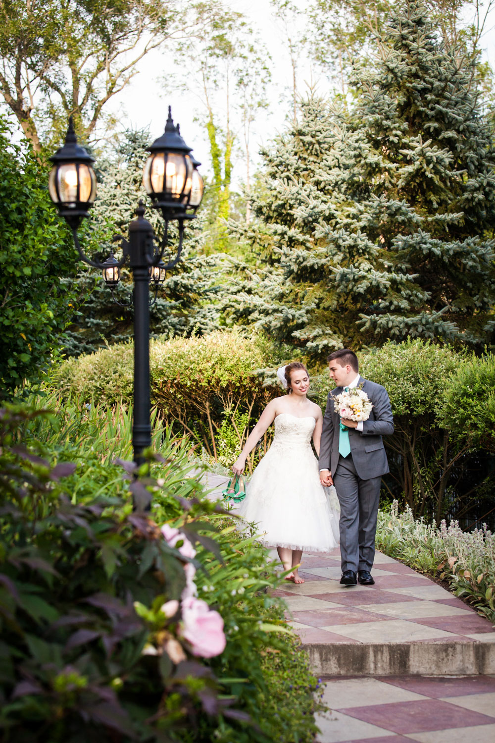 Bride and groom walking at FEAST at Round Hill House