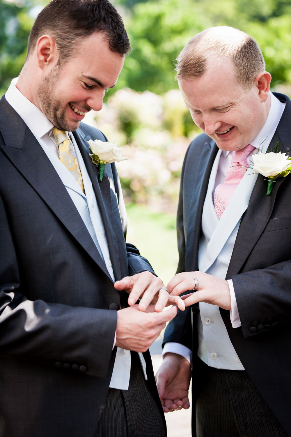 Two grooms comparing wedding rings