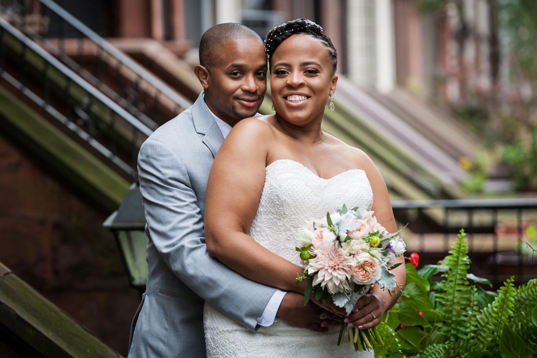 Bride and groom on stairs of Brooklyn brownstone