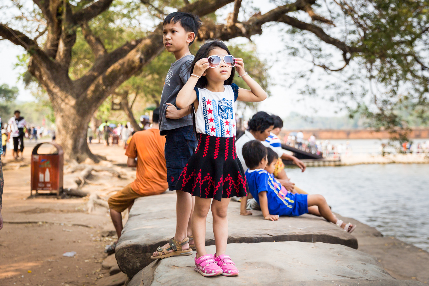 little-girl-sunglasses-angkor-wat-cambodia.jpg