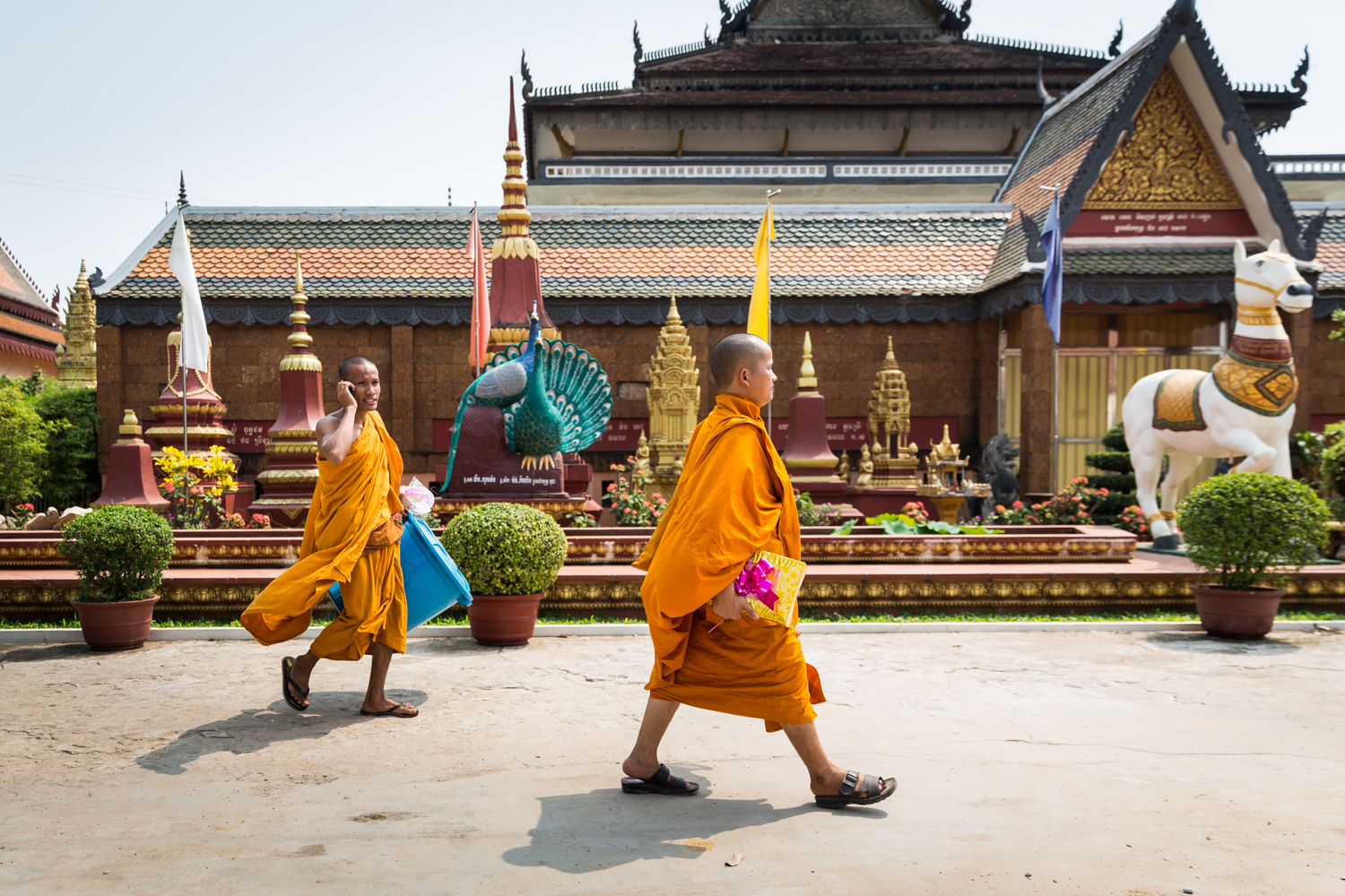 monks-orange-robes-walking-siem-reap-cambodia.jpg