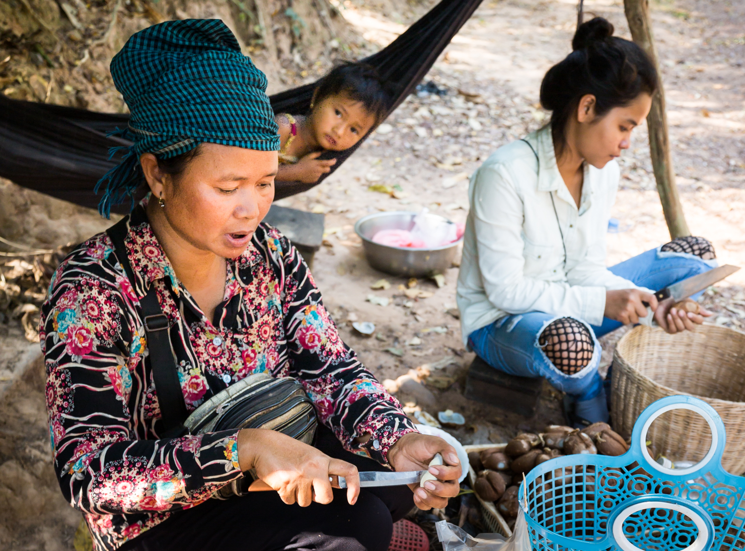 women-cutting-fruit-roadside-siem-reap-cambodia.jpg