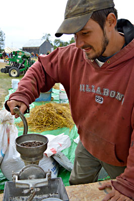 Mike Bouchard grinds buckwheat to make flour, at the Common Ground Country Fair. English photo.
