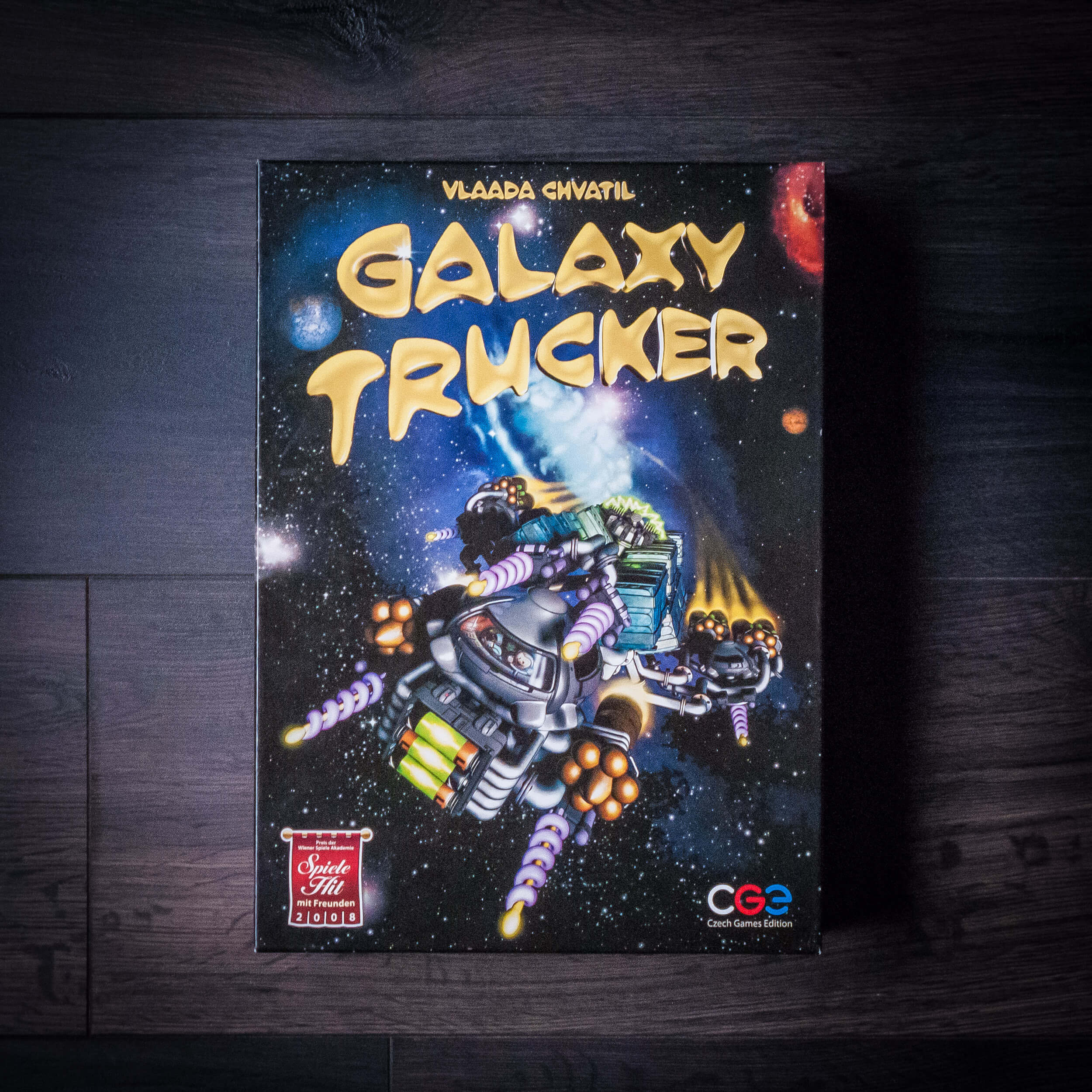 Galaxy Trucker. In this game, players quickly build spaceships out of scavenged parts, afterwards running them through a gauntlet of adventures. This results in much hilarity and agony as the players'spaceships struggle to survive in one piece.