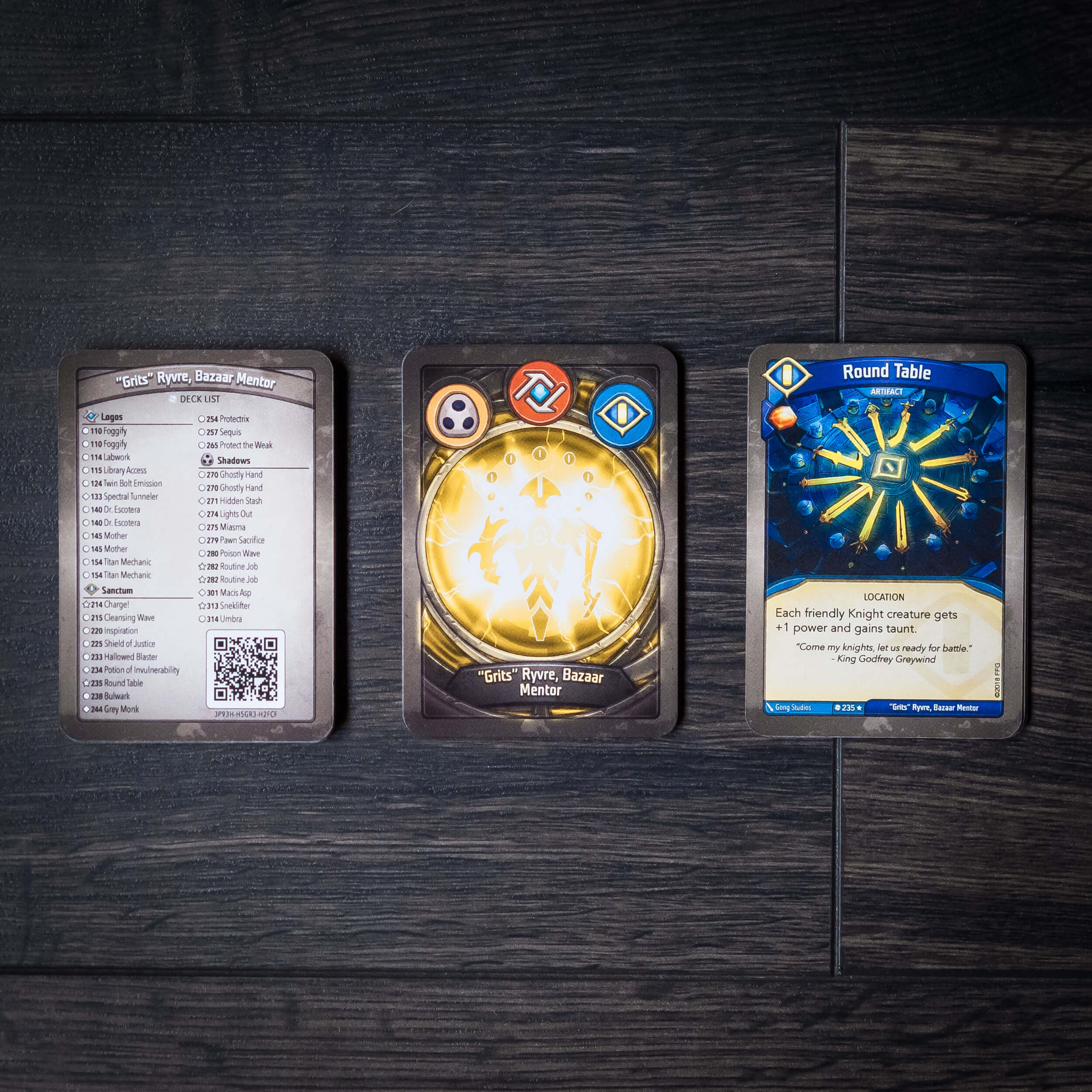 Grits' deck list on the left & card back in the middle - note that Grits' name is printed on the front of the Round Table artifact card.