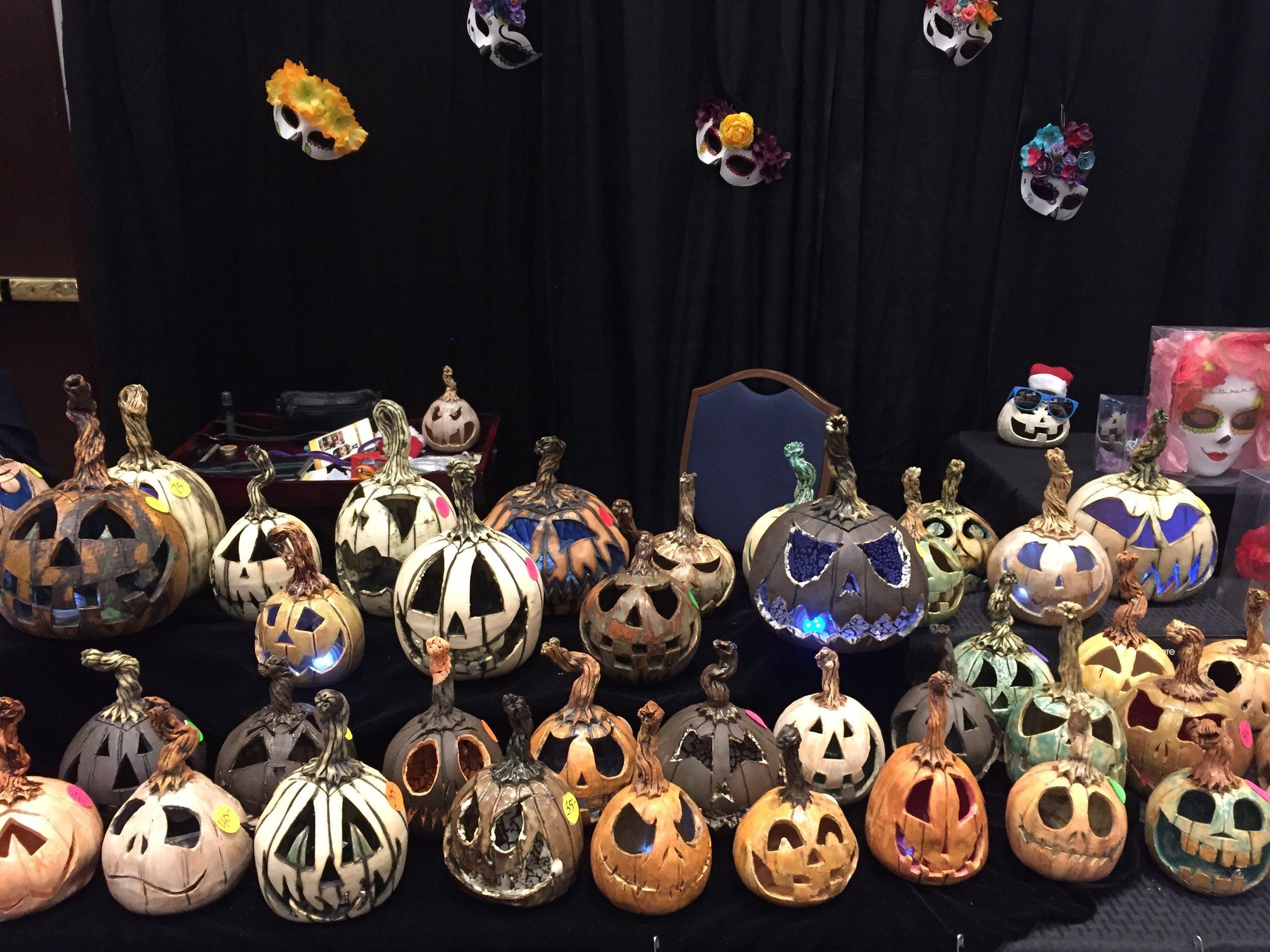 Handmade Jack 'O Lanterns from clay artist Cathy Galgano. On the  facebook @CathysJacks.