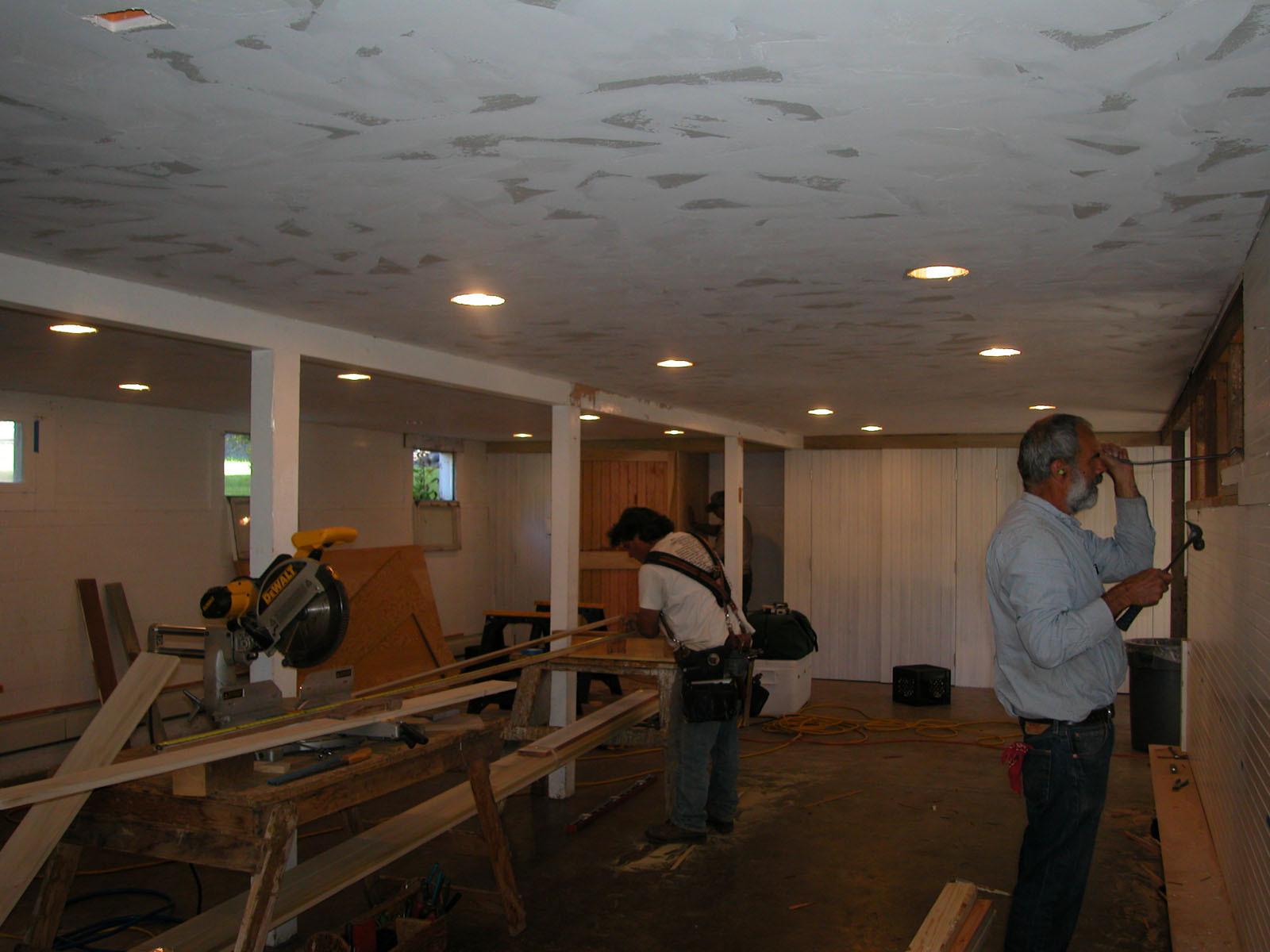 Volunteer construction crew working on a basement upgrade.
