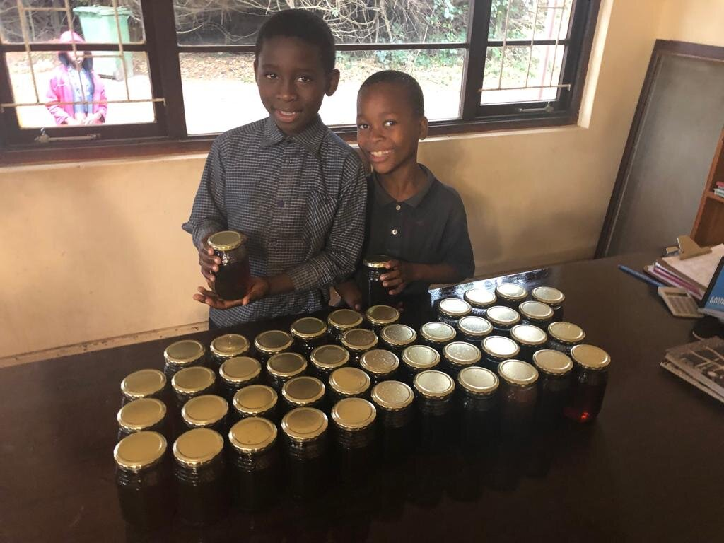 Harvesting Honey… - We have learnt how to harvest honey from 3 hives which produced 45 x 500g bottles of the most beautiful honey. We now have 12 healthy hives on the property whereby we hope the poor can make some income from the skills they have learnt.