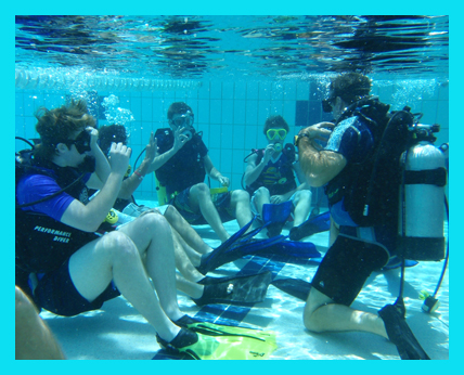 By practicing skills in a relaxed and controlled manner, the students have a greater chance of success in the pool, then the ocean.