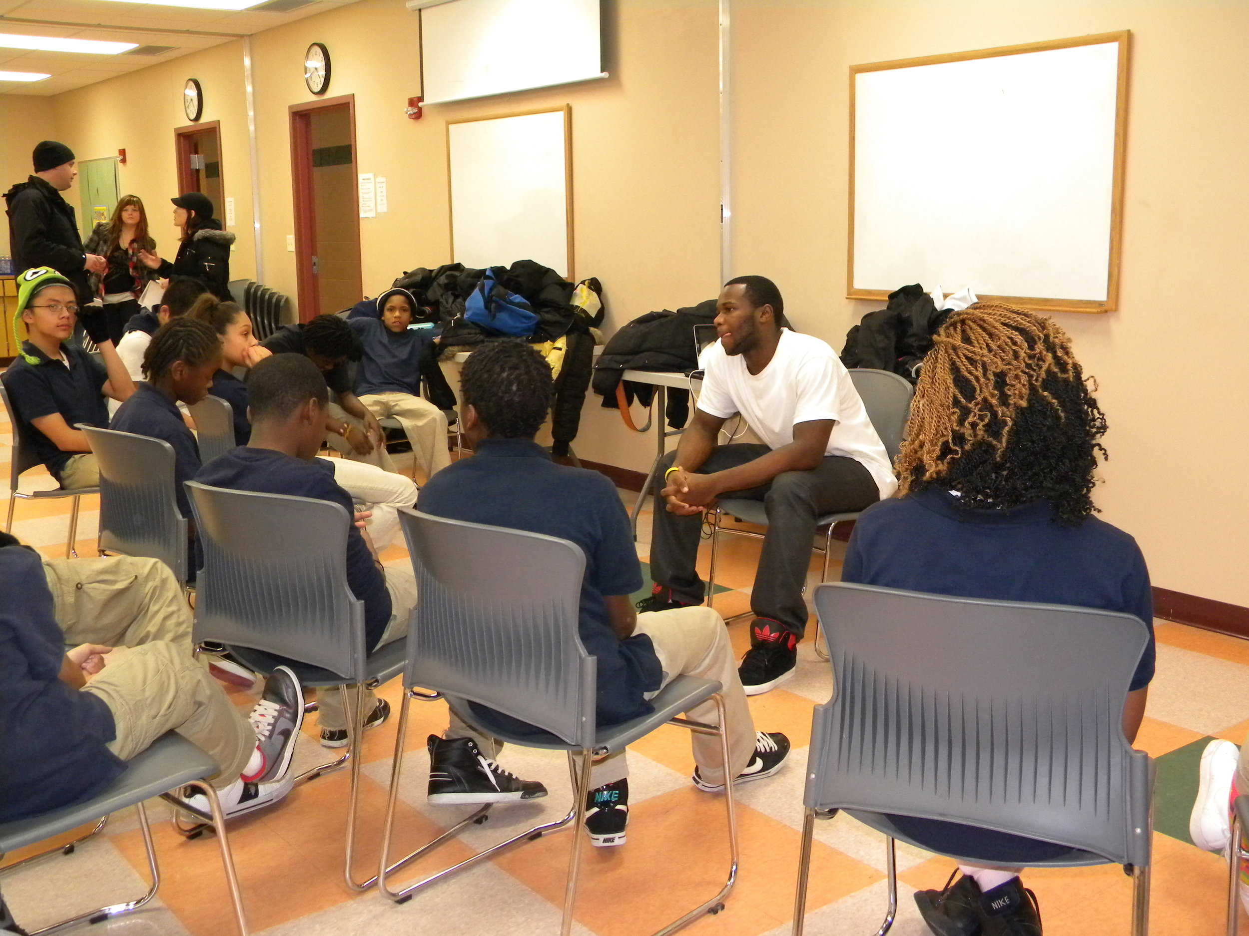 Deo speaking to students in Minneapolis.