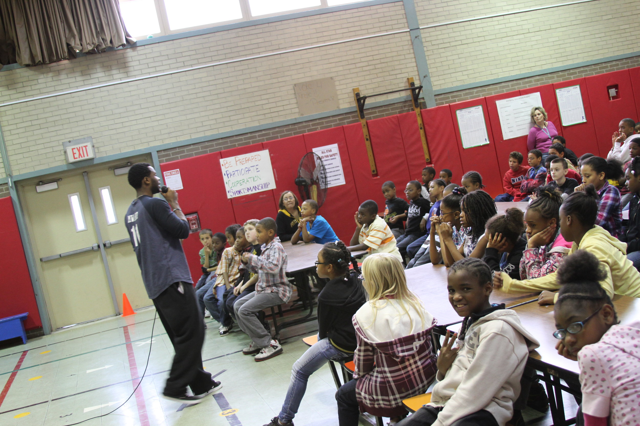 Deo speaking to a group of students in Pittsburgh, PA