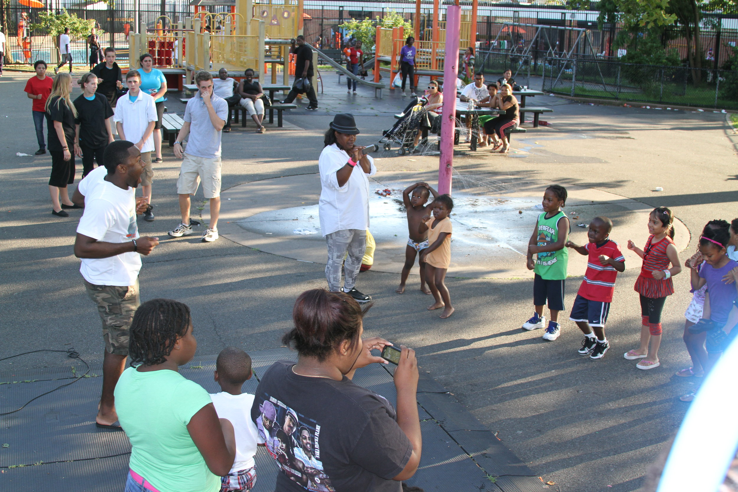 Deo working with a community through JG in Jamaica, Queens, NYC.