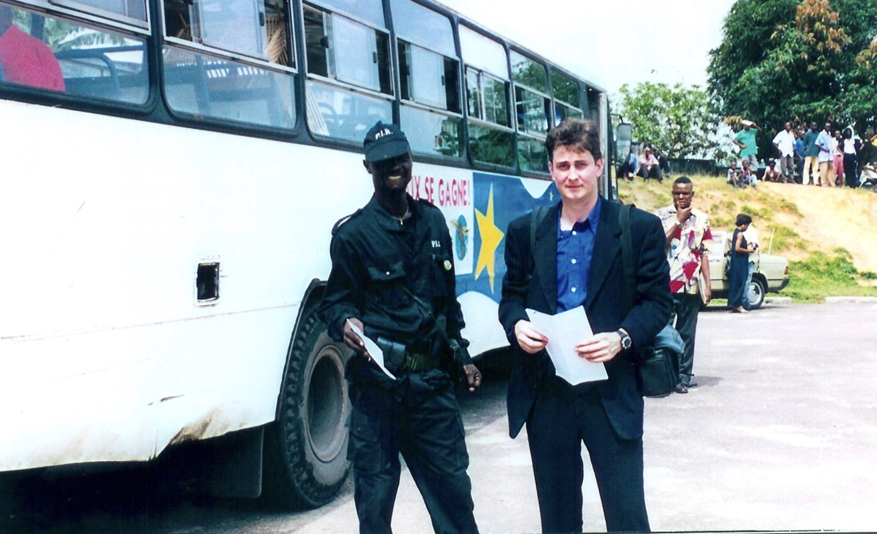 Departure time at the secret refugee compound. Sasha from IOM and Congolese policeman. Photo from Sasha Chanoff Refuge Point.