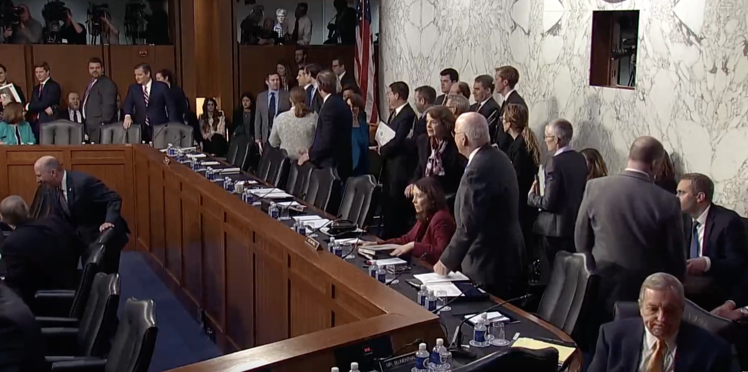 Image taken from Youtube on the Guardian news live stream of the hearing.