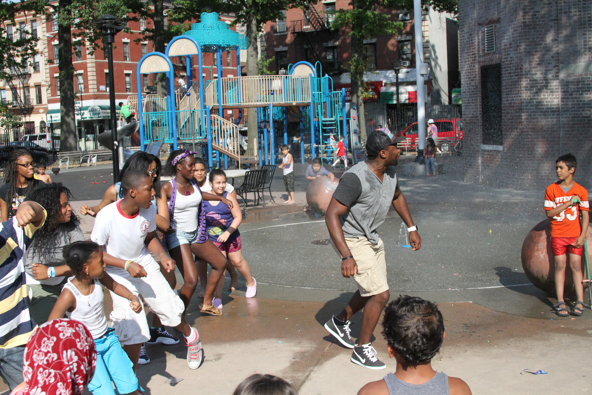 Deo teaching dance to some students in a park in Jamaica Queens, NYC.
