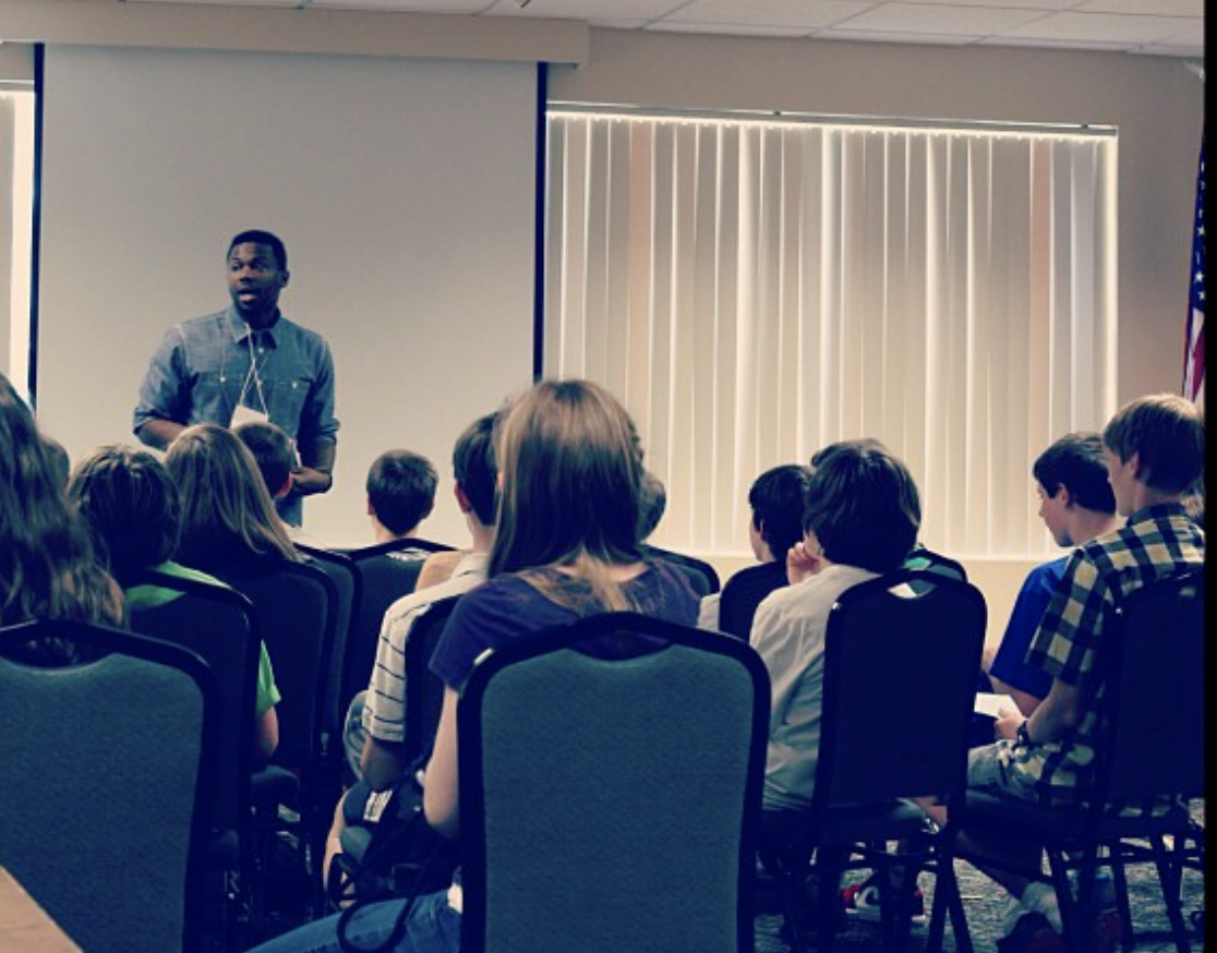 Deo Mwano leading a workshop on how to create an inclusive space with a student group