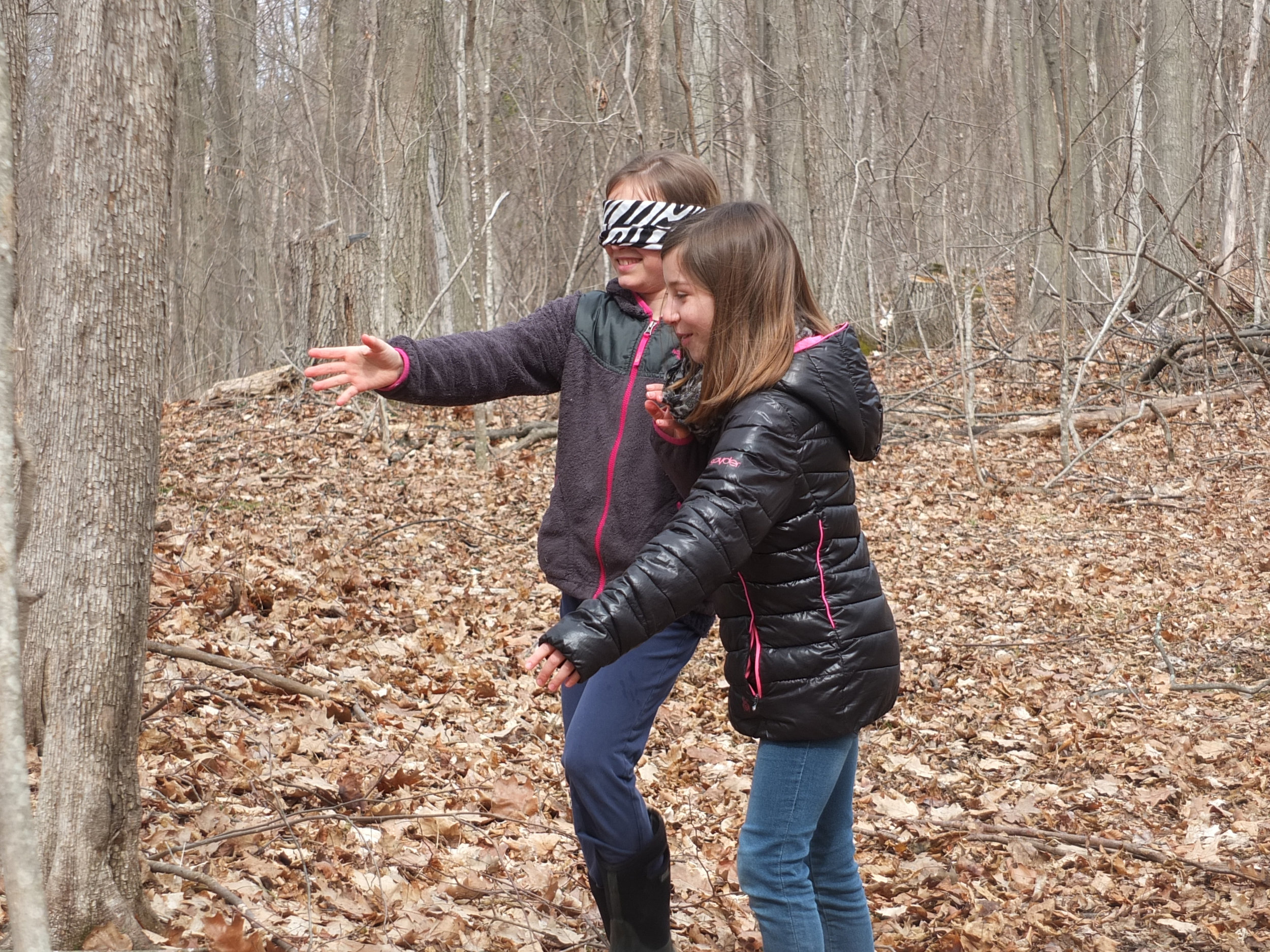 "Two girls have fun and learn to ""see"" trees in a new way on Fox Hill at Crescent Bay Farm."