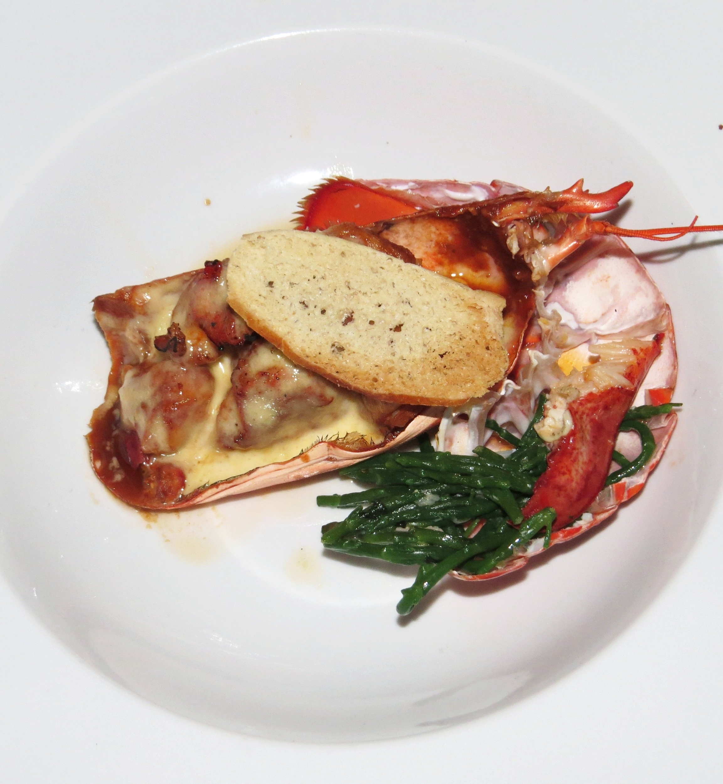 Steve's Signature Dish - Lobster Thermidor. A basic interpretation of a classic! Boiled and cracked lobster, served with a sticky bisque of onion, fennel, garlic and tomato, and Sauce Mornay.