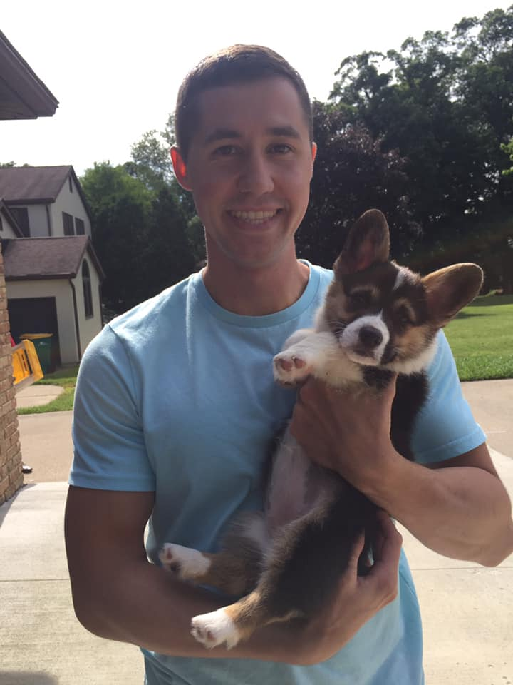 Zach Vaughn and Mabel, a 12 week old Corgi.