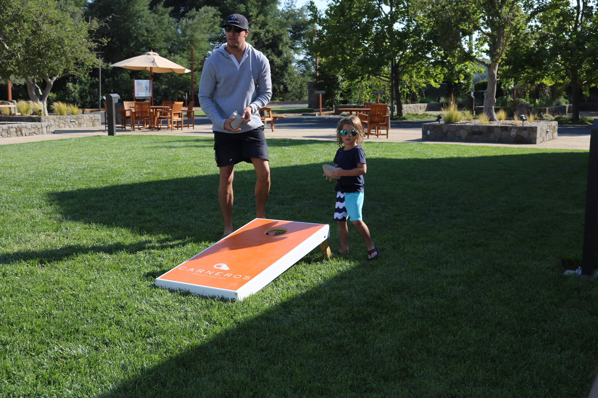 """Playing """"Corn Hole""""on the front lawn."""