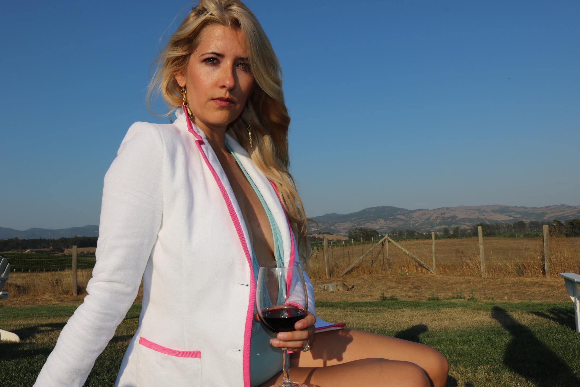 Enjoying a glass of wine in my  Bask  toweling blazer.