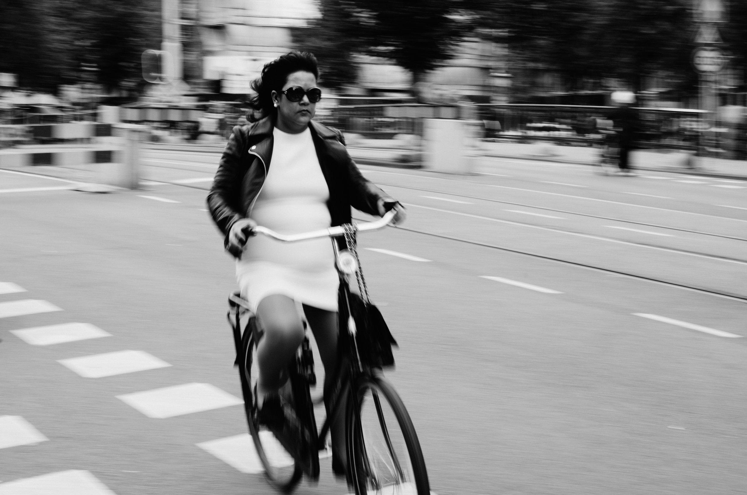 stock-photo-amsterdam-biker-2-81412459.jpg