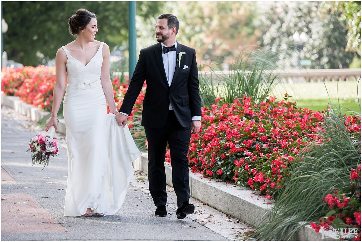 Eastern Market DC Wedding bride and groom walking portrait.jpg