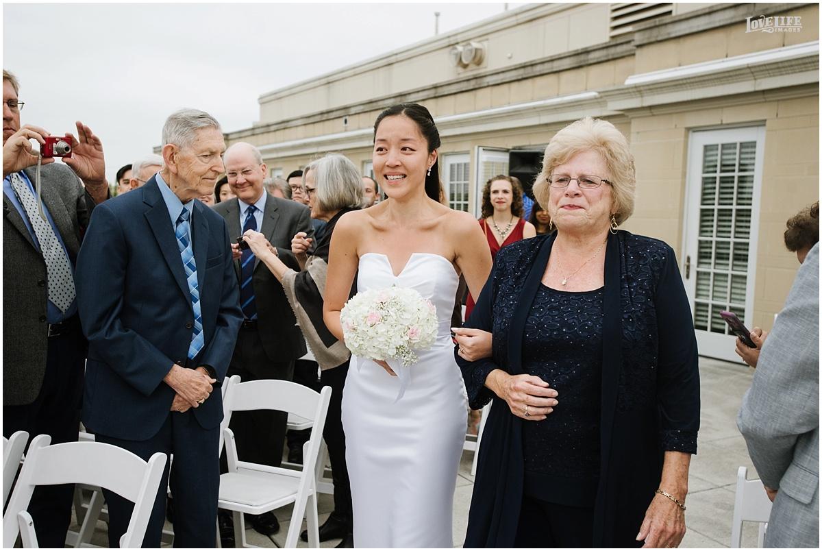 Lorien Hotel Brunch wedding bride walking down aisle with mom.JPG