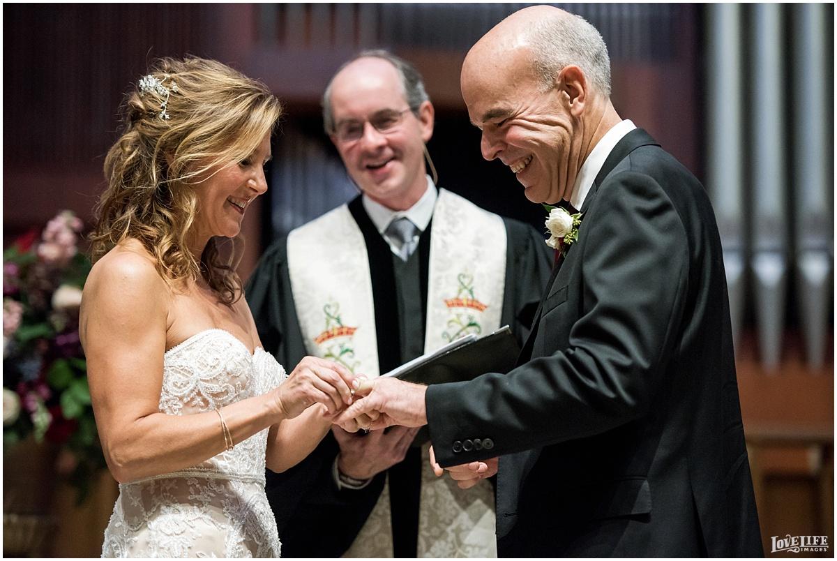 Strathmore Mansion wedding couple exchanging rings.jpg