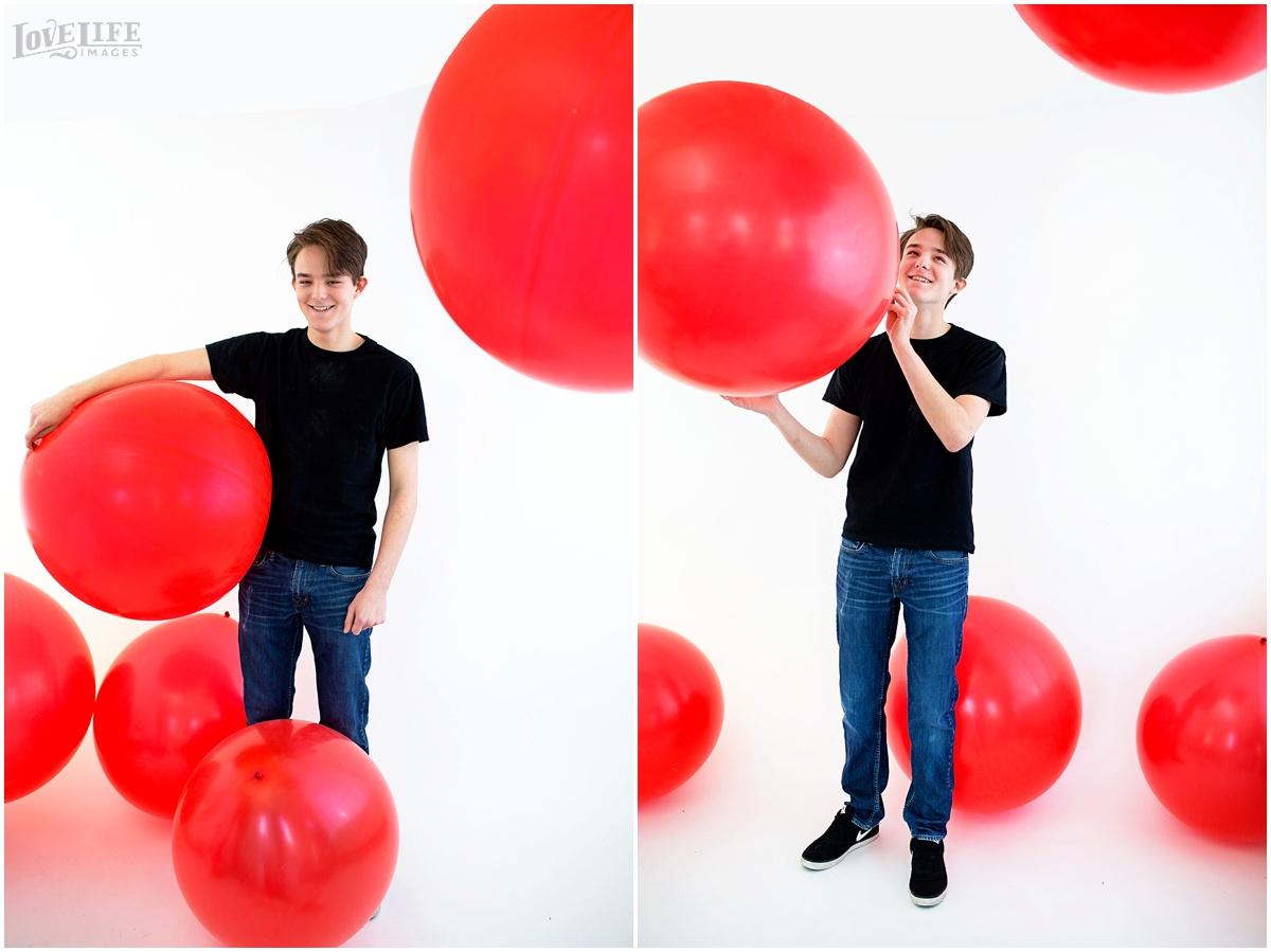 teenager in red balloon portrait room.jpg