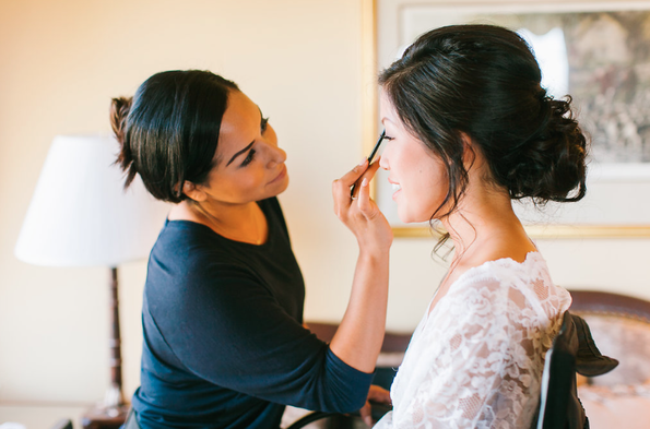 """Featured Expert:Ariel Lewis, Beauty Couture Specialist - Temptu Pro Hydrating airbrush foundation.This product makes all the difference in the world on a wedding day! When you want to look like a polished """"best"""" version of your self the foundation you use is KEY! Traditional foundation formulas such as MAC, Smashbox, or Chanel can feel heavy and when your dancing they can breakdown quickly. Airbrush makeup is what all the celebrities use on the red carpet for exactly this reason. They want to look polished but not caked in makeup. Our company specializes in custom airbrush applications. The formula we use is blended with up to 3 different hues to create your perfect skin match! You can even cry in your airbrush makeup... and we promise it wont leave streaks running down your face. Temptu can be purchased directly at:https://temptu.com/"""